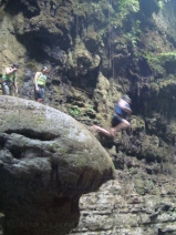 People Jumping Off the rock