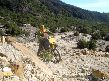 A Motorcycle on the rocky track