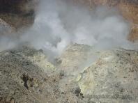 Some people near sulfuric rock