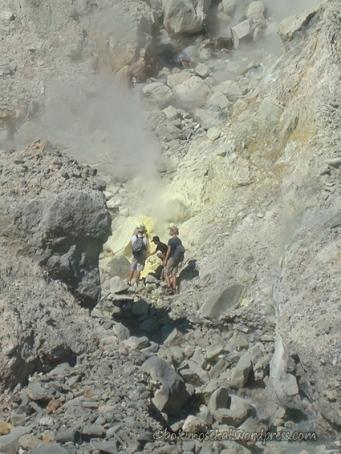 Closer look of the people near sulfur rock
