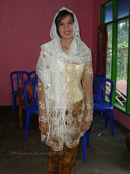 My in-law in her wedding dress made by mama